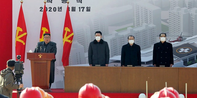 In this March 17 photo provided by the North Korean government, North Korean leader Kim Jong Un, left, delivers a speech during the ground-breaking ceremony of a general hospital in Pyongyang.