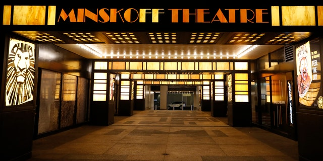 The Minskoff Theatre is shuttered Thursday, March 12, 2020, in New York, near Times Square after Broadway theaters closed following New York Gov. Andrew Cuomo's banning of gatherings of more than 500 people over concerns about the spread of the coronavirus. (AP Photo/Kathy Willens)
