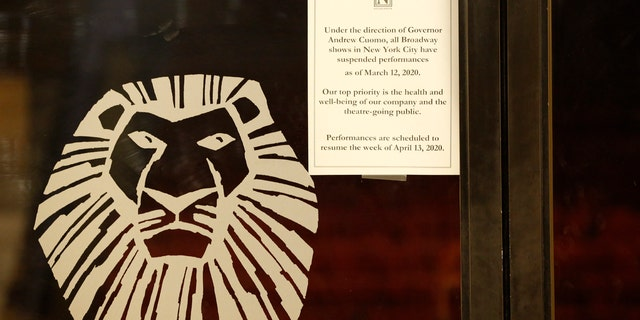 "A sign announcing the suspension of all Broadway shows is posted on a door at the Minskoff Theatre, where ""The Lion King"" had been playing, Thursday, March 12, 2020, in New York. Gov. Andrew Cuomo banned gatherings of more than 500 people. (AP Photo/Kathy Willens)"