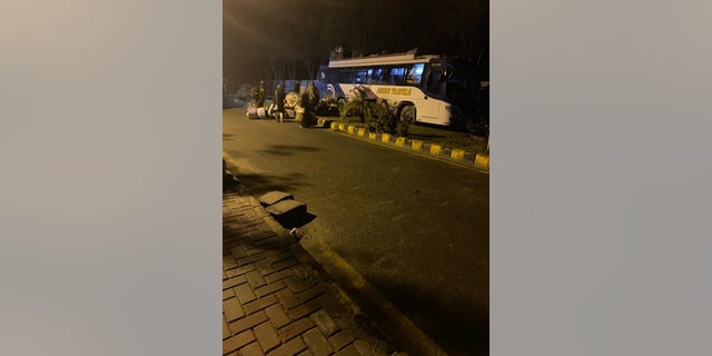A bus bringing back stranded Pakistani pilgrims from Iran to a quarantine facility in Punjab