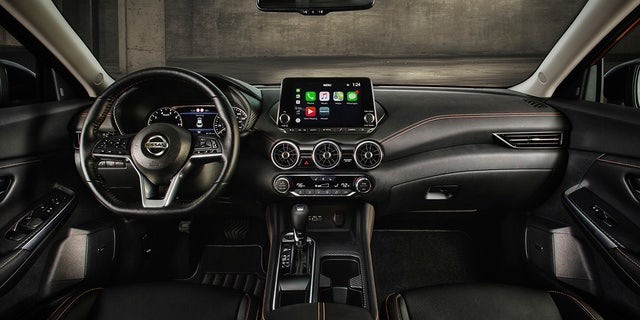 The Sentra has a tablet-style infotainment system screen.