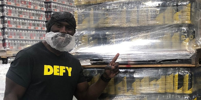 Terrell Davis and DEFY donated $400,000 worth of goods to Feeding America.