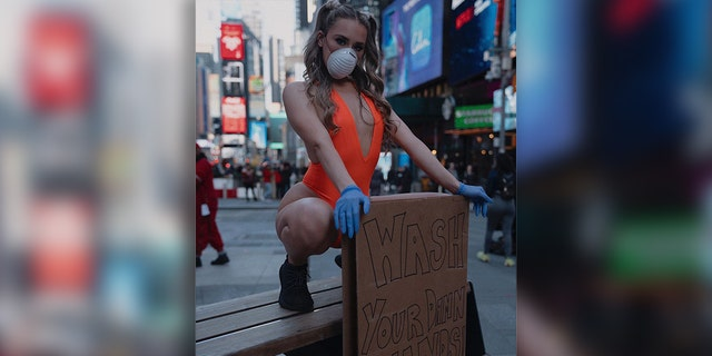 The model and host took to NYC's Time Square with her hygiene PSA.