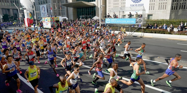 Elite runners start the Tokyo Marathon in Tokyo, Sunday, March 1, 2020. The race was scaled back as part of Japan's efforts to combat the spread of the coronavirus.