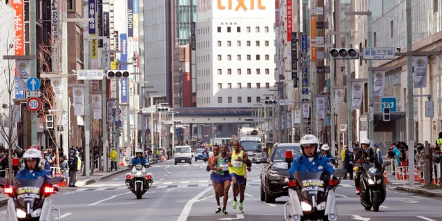 Top contenders race the Tokyo Marathon in Tokyo, Sunday, March 1, 2020. Organizers of the Tokyo Marathon reduced the number of participants out of fear of the spread of the coronavirus.