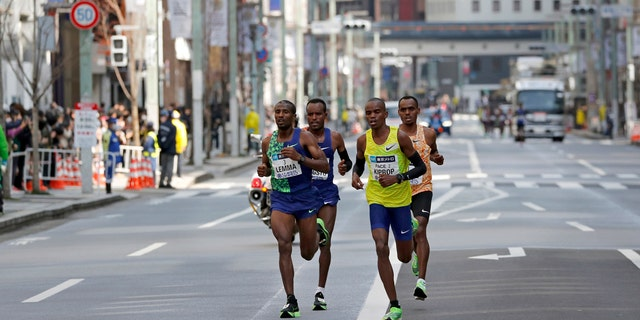 Ethiopia's Birhanu Legese, right in second row, races with other runners on his way to winning the Tokyo Marathon in Tokyo.