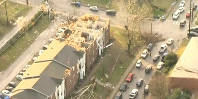 Damaged homes can be seen in one Nashville neighborhood on Tuesday.