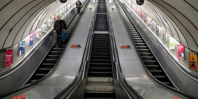 Escalators are empty at Pimlico tube station as Transport for London (TFL) starts to close down tube stations around London, Thursday, March 19, 2020.