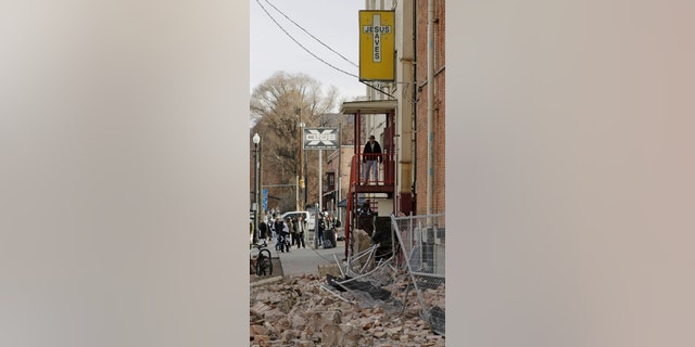 A man looks at the rubble after an earthquake Wednesday, March 18, 2020, in Salt Lake City.