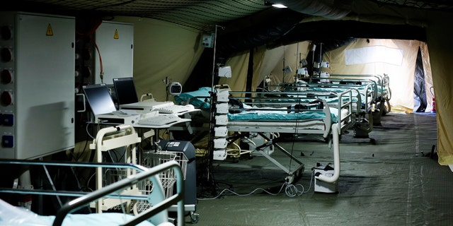 Beds line up at the military field hospital in eastern border city of Mulhouse on Tuesday. The Grand Est region is the epicenter of the outbreak in France. (Mathieu Cugnot, Pool via AP)