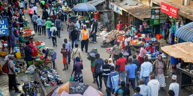 Residents walked through a small and crowded market where social-distancing is difficult, in the Mathare slum, or informal settlement, of Nairobi, Kenya, on Tuesday. (AP Photo/Brian Inganga)