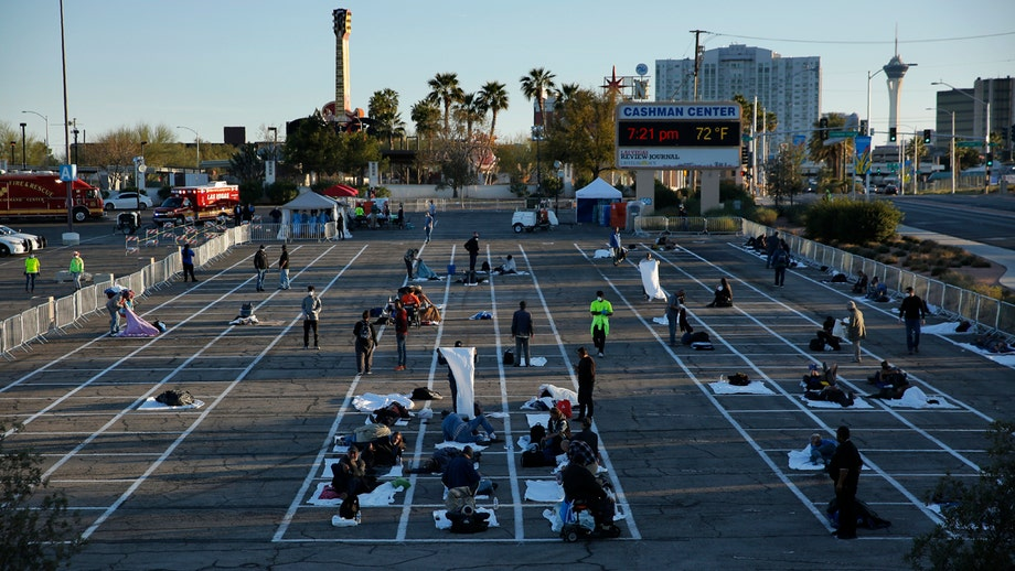 Las Vegas temporary homeless shelter after coronavirus case called 'inhumane,' people seen sleeping on asphalt