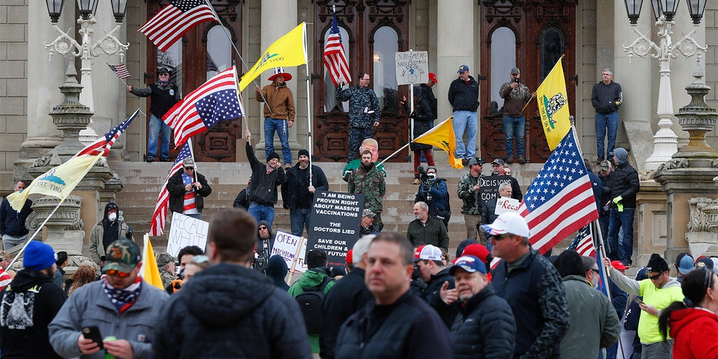 Michigan bans open carry of guns inside state Capitol