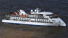 Over half of Antarctic cruise passengers on Greg Mortimer ship have tested positive for coronavirus