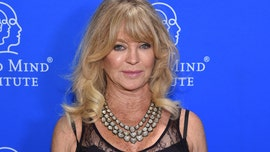 Goldie Hawn dances to 'Hey Ya!' as she cleans dishes with family in fun video