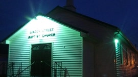 Kentucky church lights up green to show compassion for health care workers