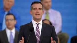 LA Mayor Garcetti takes knee at George Floyd protest, faces backlash for calling National Guard