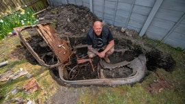 Man working in yard during coronavirus lockdown discovers mysterious car buried for over 50 years