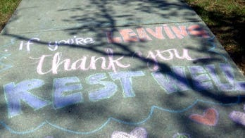 Anonymous New Orleans artist leaves uplifting messages on sidewalk outside hospital