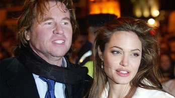 Val Kilmer says he 'couldn't wait' to kiss co-star Angelina Jolie and 'buy her a jet'