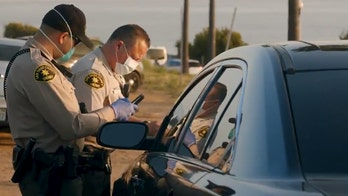 Coronavirus stay-at-home order in California has police giving citations to people watching sunset at beach