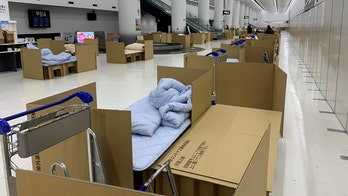 Japan airport sets up cardboard beds for travelers waiting for coronavirus test results
