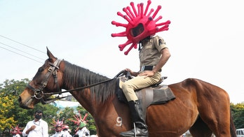 Police in India raise coronavirus awareness with virus costumes while directing traffic, on patrol