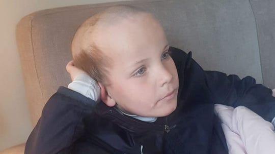 Little kid gives himself an 'old man' haircut while in lockdown with dad and brother