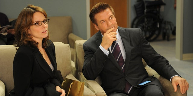 Tina Fey as Liz Lemon and Alec Baldwin as Jack Donaghy in '30 Rock.' (Photo by: Ali Goldstein/NBCU Photo Bank/NBCUniversal via Getty Images via Getty Images)
