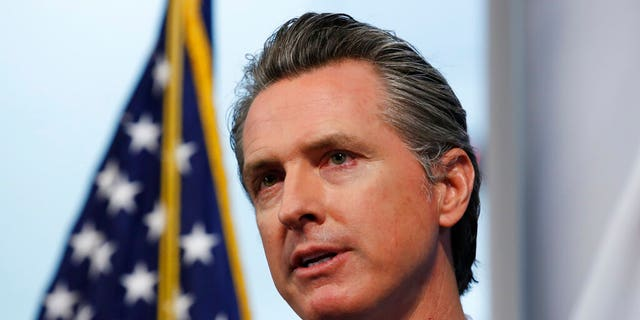 California Gov. Gavin Newsom speaking at a news briefing at the Governor's Office of Emergency Services in Rancho Cordova, Calif. earlier this month.