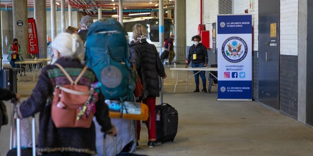 U.S. citizens stranded in South Africa ready to board an evacuation flight back to the United States.