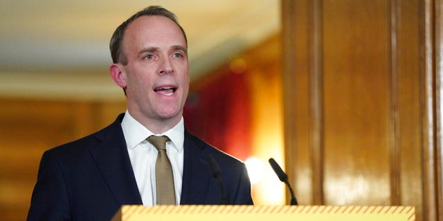 Britain's Foreign Secretary Dominic Raab answers questions from the media via a video link during a media briefing on coronavirus in Downing Street, London, Monday, March 30, 2020.