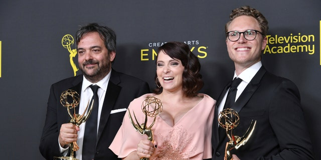 FILE - This Sept. 14, 2019 file photo shows Adam Schlesinger, from left, Rachel Bloom and Jack Dolgen in the press room with the awards for outstanding original music and lyrics for 'Crazy Ex Girlfriend' at the Creative Arts Emmy Awards in Los Angeles.