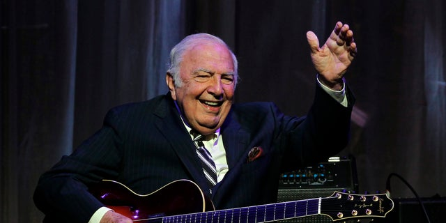 """John """"Bucky"""" Pizzarelli after being inducted into the New Jersey Hall of Fame during the induction ceremony in Newark, N.J. in 2011. The virtuoso who performed mostly modern interpretations from the Great American Songbook died on Wednesday, April 1, 2020, in his home in Saddle River, N.J., at the age of 94. (AP Photo/Rich Schultz, File)"""