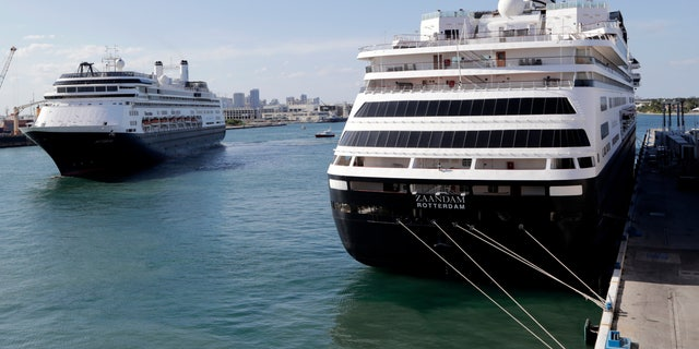 Holland America's cruise ship Rotterdam, left, arrives at Port Everglades as the Zaandam, right, is docked during the new coronavirus pandemic on April 2 in Fort Lauderdale, Fla. (AP Photo/Lynne Sladky)