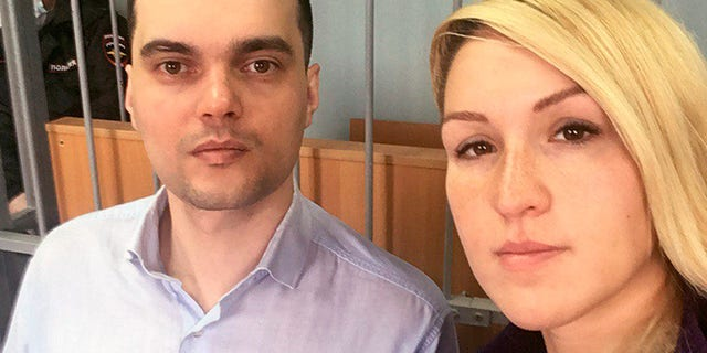 In this handout photo released by the Foundation for Fighting Corruption, Dr. Anastasia Vasilyeva of the Alliance of Doctors union, right, and the Foundation for Fighting Corruption's lawyer Vyacheslav Gimadi sit in court room in Okulovo, Novgorod region, on Friday. (AP/The Foundation for Fighting Corruption)
