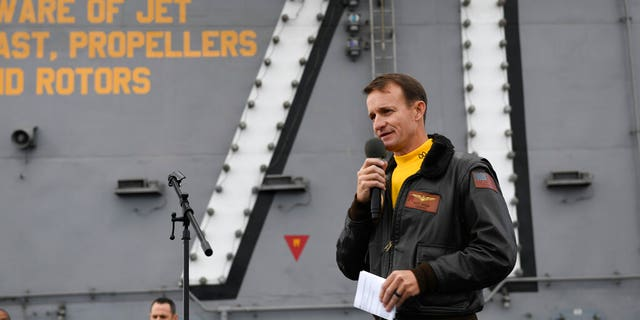 In this Nov. 15, 2019, photo U.S. Navy Capt. Brett Crozier, commanding officer of the aircraft carrier USS Theodore Roosevelt (CVN 71), addresses the crew during an all-hands call on the ship's flight deck while conducting routine operations in the Eastern Pacific Ocean. (U.S. Navy Photo by Mass Communication Specialist 3rd Class Nicholas Huynh via AP)