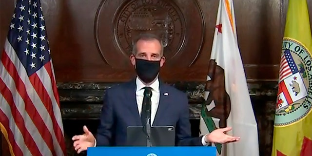 Los Angeles Mayor Garcetti wearing a protective face mask during his daily coronavirus news conference in Los Angeles on April 1. Garcetti is currently conducting all briefings and interviews remotely. (Office of Mayor Eric Garcetti via AP, File)