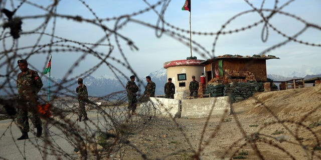 Afghan National Army soldiers stand guard at a checkpoint near the Bagram base in northern Kabul, Afghanistan, Wednesday, April 8, 2020. (AP Photo/Rahmat Gul)