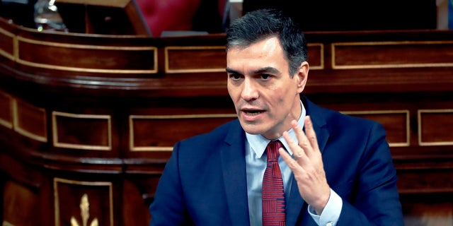 Spain's Prime Minister, Pedro Sanchez speaks at a parliamentary session in Madrid, Spain, Thursday. Sanchez acknowledged that Spain's government, and its regions which administer health services, were caught off guard by the crisis and left its hospitals woefully short on critical supplies, including virus tests and protective clothing for medical workers.(Mariscal, Pool photo via AP)