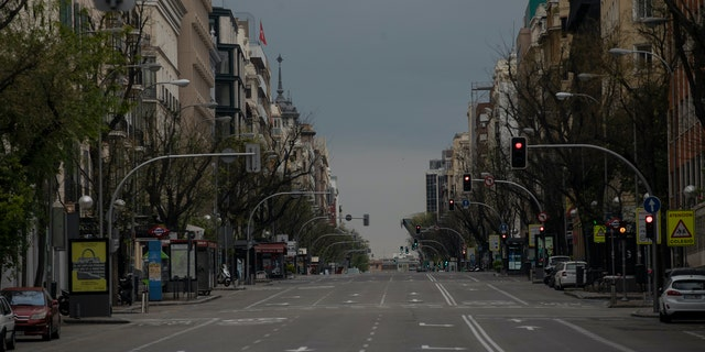 An empty street as the lockdown continues to combat the spread of coronavirus in downtown Madrid, Spain, Thursday. The new coronavirus causes mild or moderate symptoms for most people, but for some, especially older adults and people with existing health problems, it can cause more severe illness or death. (AP Photo/Manu Fernandez)