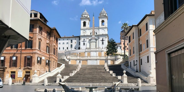 A view of the empty Piazza di Spagna, at the foot of the Spanish Steps, following the coronavirus lockdown measures, in Rome, Thursday. The new coronavirus causes mild or moderate symptoms for most people, but for some, especially older adults and people with existing health problems, it can cause more severe illness or death. (AP Photo/Karl Ritter)