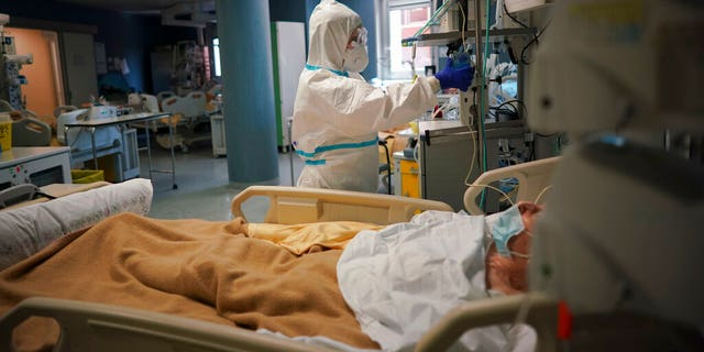 Medical staff tends to a patient in the ICU unit of Rome's San Filippo Neri Hospital's Covid department, in Rome, Thursday, April 9, 2020.