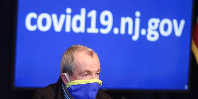 New Jersey Gov. Phil Murphy holds a news conference regarding the COVID-19 cases at the War Memorial in Trenton, N.J. on Saturday, April 11, 2020. Murphy says he is ordering state transit systems to reduce their capacity by half and will require all transit riders to wear face coverings.
