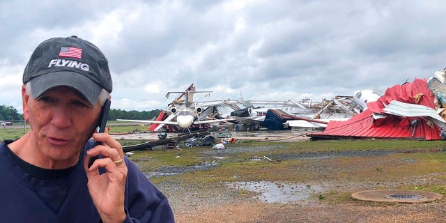 Rep. Ralph Abraham seen talking on his phone in front of a destroyed hangar and damaged planes at Monroe Regional Airport in Monroe, La.