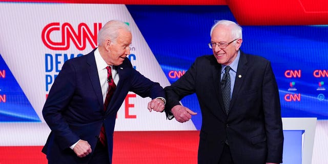 """March 15, 2020: Former Vice President Joe Biden, left, and Sen. Bernie Sanders, I-Vt., right, greet one another before they participate in a Democratic presidential primary debate at CNN Studios in Washington. Sanders said Tuesday that it would be """"irresponsible"""" for his loyalists not to support Joe Biden, warning that progressives who """"sit on their hands"""" in the months ahead would simply enable President Donald Trump's reelection (AP Photo/Evan Vucci)"""