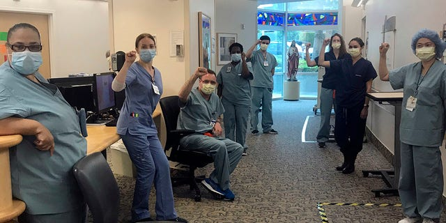 In this image provided by Lizabeth Baker Wade, nurses at Providence Saint John's Health Center in Santa Monica, Calif.(Lizabeth Baker Wade via AP)
