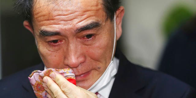 Thae Yong Ho, former North Korean diplomat, who defected to South Korea in 2016 and a candidate of the main opposition United Future Party, wipes his tear after he was certain to secure victory in the parliamentary elections in Seoul, South Korea, Thursday, April 16, 2020. Thae on Thursday won a constituency seat in South Korea's parliamentary elections, the first such achievement among tens of thousands of North Koreans who have fled their authoritarian, impoverished homeland.