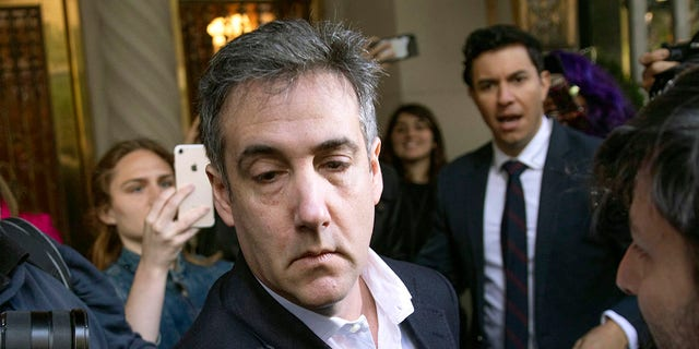 In this May 6, 2019, file photo, Michael Cohen, former attorney to President Donald Trump, leaves his apartment building before beginning his prison term in New York. (AP Photo/Kevin Hagen, File)