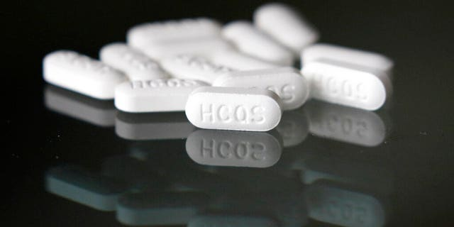 FILE: An arrangement of hydroxychloroquine pills in Las Vegas. O